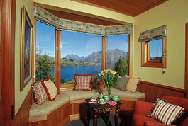 View from the Southern Cross Suite looking across Lake Wakatipu with Cecil Peak in the background - click for more pictures and details.